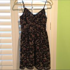 Urban Outfitters Dress Beautiful dress from Urban Outfitters. I love the dress and the only reason I am parting with it is because it no longer fits me . Pretty details include a corset lace up back (pic 3), buttons up the front (pic 4), adjustable straps and delicate lace trim around too and bottom of dress. Dress is in perfect condition. Urban Outfitters Dresses Mini
