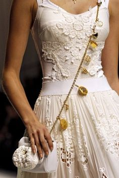 Dolce and Gabbana, model, runway, haute couture, couture, fashion, high fashion, Milan Fashion Week, fashion week, lace, crochet, pleats, floral, coins, flowers, detail, embroidery, Dolce and Gabbana Couture, couturier, atelier, fashion designer, corset, purse, gold, Spring 2011, Jac, Monika Jagaciak, cutouts,