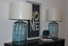 Custom Vintage 5 gallon glass water jug repurposed as a more contemporary lamp with pottery barn drum shades. How cool would this be with 1 gallon jugs and burlap shades! Glass Water Jug, 5 Gallon Water Bottle, Water Jugs, Light My Fire, Old Bottles, Contemporary Lamps, Mason Jar Lamp, Drum Shade, Bottle Crafts
