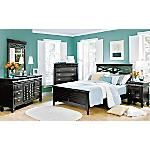 Simplistic beauty and elegance come together in our Plantation Cove® 5-Piece Panel Bedroom Set.  Made from all-wood construction.  Bed combines lattice and louvered design elements.   Our Plantation Cove Dresser has fully-functional louvered doors.    Behind the doors are three drawers lined with cedar.   Top storage drawers have sliding, felt-lined, removable jewelry trays.    The fluted cup handles have a brushed nickel finish.    Our Plantation Cove Mirror has beveled glass.   It's both a…