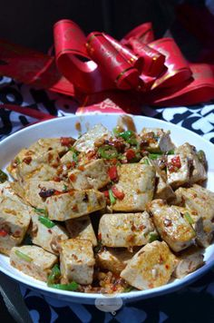 Sautéed Tofu with Minced Pork is one of the most common homemade cuisine on the table of Chinese family and also a suitable dish to entertain guests. It is tasty and healthy. Tofu is soft, suitable for elder and kids. the cooking method is simple, is a really simple chinese recipe, you can cook it within 20 minutes.