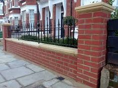Brick Wall Stone Cap - If you are currently looking for some great brick wall suggestions for landscaping, why don't you vi Brick Wall Gardens, Brick Garden, Brick Fence, Garden Walls, Garden Railings, Gates And Railings, Garden Wall Designs, Red Brick Walls, Home Exterior Makeover