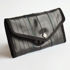 Queen Anne Wallet >> Alchemy Goods >> Seattle, WA >> A super-sized wallet for the ultra-organized. Folds open to 4 credit card slots, an ID window, pen holder, cash pocket, another for receipts, and a zippered coin pouch. Measures 8 by 0.5 by 4 inches. $58 at NuBe Green