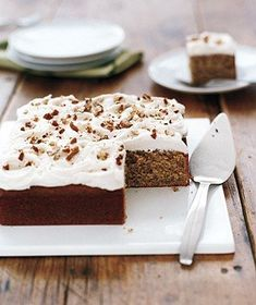 Pecan Cake With Rum Frosting | A delightfully nutty cake topped with vanilla-rum frosting, this dessert feels at once humble and downright celebratory. The dense cake, made with a standard buttermilk batter that gets its deep hue from over a cup of ground pecans, slices beautifully, and the finished product is an ideal pairing with a cup of strong coffee, a big glass of milk or even, in deep winter, a spicy hot toddy. Try our Pecan Cake in place of a traditional pie for Thanksgiving or a…