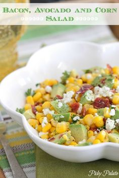 Bacon, Avocado and Corn Salad 5 strips Thick cut bacon 4 ears corn, husks and silks removed 2 ounces cotija cheese (feta cheese may be substituted) 2 tablespoons chopped fresh cilantro 1 lime, juiced 1 Hass avocado coarse salt ground black pepper to taste Corn Avocado Salad, Bacon Avocado, Corn Salads, Avocado Food, Great Recipes, Favorite Recipes, Cooking Recipes, Healthy Recipes, Cooking Food