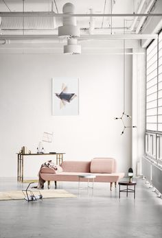 Blush pink sofa in the minimalistic industrial living room
