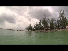 GoPro HD: Rum Point Grand Cayman Cloudy Day.  Rum Point in the Cayman Islands is awesome...even on a cloudy day!  I filmed this video with my GoPro in the water at Rum Point.  Please share this video with others and be sure to watch my other GoPro videos and travel videos too!  Have a great day!