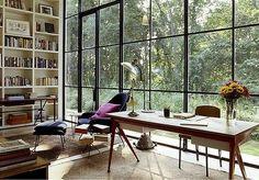 black window wall, slant leg desk, royal lounge chair w/violet pillow