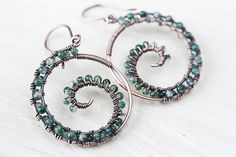 Moss agate earrings, round wire wrapped copper hoop by CookOnStrike, Etsy.  (Normally I don't like crafty jewelry, especially wire-wrap, but this is well executed and a nice design.)