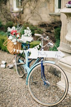 Vintage bicycle with basket full of flowers, Bunting & Direction Sign | Wedding Decor | Wedding ideas | Elegant Wedding At Eshott Hall Northumberland | Blush Pink Peach Colour Scheme | Groom In Pale Pink Suit By Paul Smith | Images by M&J Photos | Film by Clark and Palmer Wedding Films | http://www.rockmywedding.co.uk/tessa-george-2/