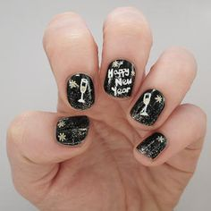 Mark the new year with a celebratory mani. This New Year's nail art will have you raising a glass to 2015 in style!