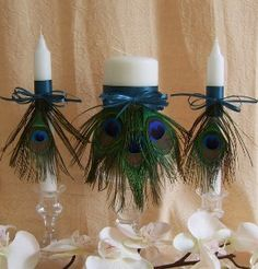 Peacock feathers give a luxe look. imagine with chocolate brown table linens and cream dishes.