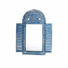 Antique distressed blue, Mediterranean style window frame with louvered shutters…