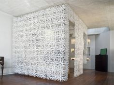 Filigree ceiling hung partition