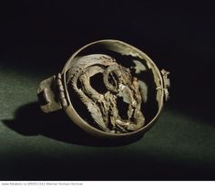 Locket containing the remains of a snake. Such amulets were believed to have magical properties. Country of Origin: Sweden. Culture: Viking. Material: copper.