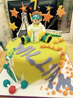 Mad science themed birthday party cake. More matching science themed children's birthday stationery at HipHipHooray.com