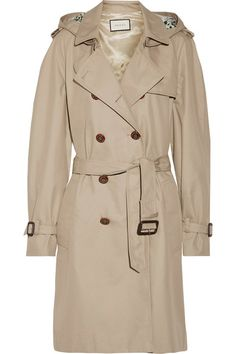 Gucci's trench coat has a floral-print silk-faille storm flap that's inscribed with the word 'Loved' - a nod to the 'Blind for Love' signature first seen on the label's Resort '17 runway. Made from moisture-wicking cotton-blend gabardine, it has 'GG'-embossed red and green buttons and traditional details including buckled cuff tabs and shoulder epaulettes. The removable hood is perfect for stormy days.