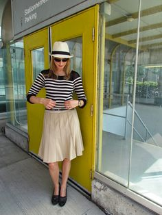 Nautical sweater with mesh shoulder detailing, pleated skirt with lace underlay, fedora, suede wedges with tassles