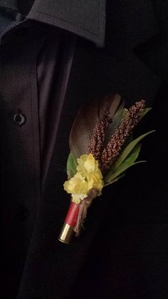 Wedding Boutonniere (Boutineer) - Shotgun Shell filled with Mixed Flowers, Feathers and Cattails on Etsy, $9.25