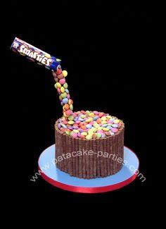 Anti-gravity cake Smarties cake. A **VERY** quickly put together cake for my baby's birthday! Happy birthday to my darling DanDan... a teenager!!!! I can't believe it. Daniel's favourite cake is egg-free chocolate orange sponge and his favourite sweets are Smarties, so that's exactly what he got. x x x