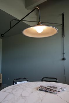 vintage office lights that can be raised, lowered and moved around the room.