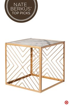 Easily dress up your home in modern, gilded flair with the intricate Nate Berkus Criss Cross Accent Table. Sleek and stylish, this table features a luxurious gold tone, sophisticated geometric design and beautiful marble top—perfect for accommodating books, candles and other accent pieces.