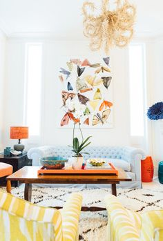 Blue and orange living room colors with gold chandelier