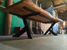 underside of the slab table with complete view of unique steel base