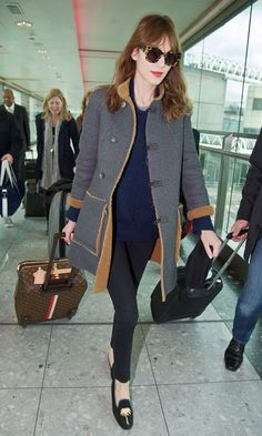 Alexa Chung in Penelope Chilvers Palm Tree velvet slippers at Heathrow airport