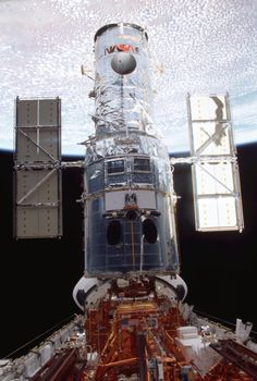 March 8, 2002 – The Hubble Space Telescope is anchored in the open bay of the Shuttle Columbia as it gets repaired and upgraded by astronauts. (NASA)