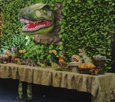 Jurassic Park | CatchMyParty.com. LOVE this!! I would love to find some full size Dino cut-outs to hide in the bushes (assuming its not raining ;-)
