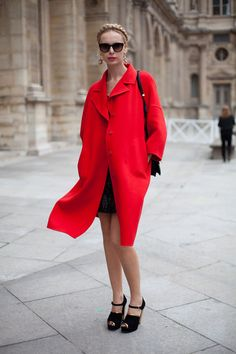 STREET STYLE SPRING 2013: PARIS FASHION WEEK - A major red coat always takes center stage.