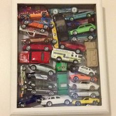 Car shadow box. DIY cherished memories & mementos organization idea. Our boys favorite childhood toys saved for display or as keepsake. My son is growing up so fast.