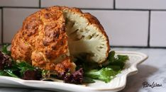 Spicy Whole Roasted Cauliflower Recipes PureWow Whole Roasted Cauliflower, Cauliflower Recipes, Vegetable Recipes, Vegetarian Recipes, Cooking Recipes, Healthy Recipes, Roasted Califlower, Parmesan Cauliflower, Cauliflower Steaks