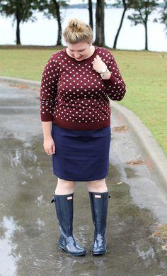 Navy hunter boots, navy pencil skirt, and a garnet and grey polka dot cardigan
