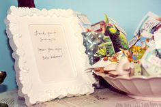 book theme baby shower 'bookworm' gummy worm favors sewn vintage book page packages