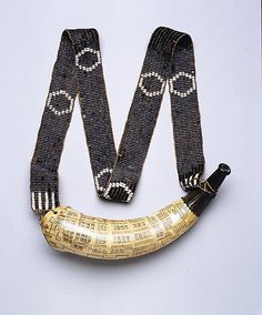 Powder Horn and Shoulder Strap - 18th century - Horn leather wampum - American  MET 39.87a,b   Inscribed: CHARLESTOWN SOUTH CA/ROLINA NO 1 BATTERY NO 2 E FORT / 3 OLD BARRACKS 4 NEW BARRAC/KS / A.D. 1770 MADE BY D B