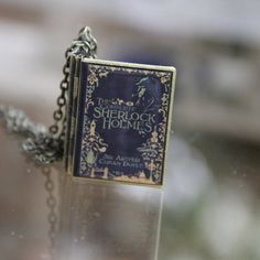 Sherlock Holmes book locket w/ chain large by sparklelab on Etsy, $20.00 she makes the cutest lockets using book covers, album covers, movie posters, screen caps. She has different sizes. LOVE! <-- *gasp*