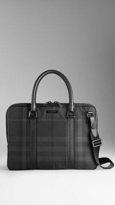 Beat Check Briefcase | Burberry $1,095.00 Item 38022171 BLACK         Beat check briefcase with leather trim         Top zip closure, rolled handles, detachable webbed nylon shoulder strap         Interior document pocket and matte metal hardware         27 x 37 x 7cm         10.6 x 14.6 x 2.8in         95% polyamide, 5% acrylic with leather trim         Imported