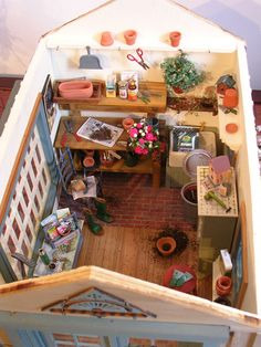 The floor is wood and brick. Many of the interior accessories are painted metal miniatures. Garden products are by Wright Guide and the boots are by the Dolls' Cobbler. REVISIT from PC!