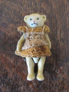 ANTIQUE HERTWIG & Co MINIATURE WIRE JOINTED BISQUE TEDDY BEAR IN CROCHETED DRESS