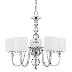 Add an elegant touch with this five-light chrome chandelier. Unique glass balls accent this lighting fixture, and drum shades soften each of the five required bulbs. A shiny chrome finish completes the luxurious look of this chandelier.