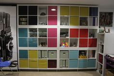 Love using IKEA's Expedit units (looks like six of the 8 box version) along with the colorful door add ons and storage bins to make a great garage unit!
