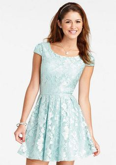 Cap-sleeve allover lace dress with sparkle shine finish. Pleated fit and flare shape skirt. Full back coverage and back zipper for better fit.
