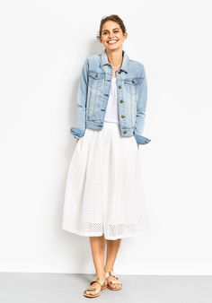 """This trend-led piece is perfect for summer. Light and airy, wear this stylishly pretty skirt with your favourite denim jacket. • Relaxed fit. Try your usual size. • Cut out perforated pattern. • Elasticated waist. • Mid rise, sits at your natural waist with 2 front pockets. • Midi length, sits mid calf depending on height. • Model is 5'9"""" and wears size 10."""