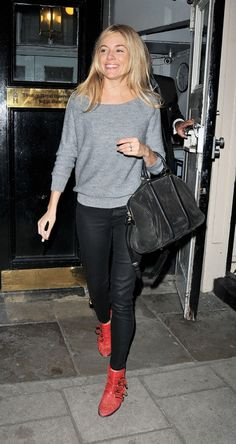 Sienna Miller wears a sweater, skinny jeans, red Chloé ankle boots, and a suede satchel
