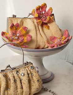 Ravelry: #150 Les Tuileries Evening Bag Pattern pattern by Nora J. Bellows.  Treat yourself to something special for that special occasion.  Recommended yarns:  Artyarns Beaded Pearl and Sequins and Louisa Harding Grace Hand Beaded.  Yarns and Pattern can be found at Knit & Pearls in Avon CT