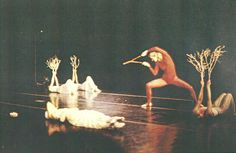 Daina Shukis down stage as the Cocoon in a modern dance production of her own choreography of Tlaloc's Forest.