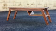 A classic styled mid century modern coffee table. Solid walnut with a oil /poly blend finish. . Dimensions 49 1/2 L x 16 1/4 D x 15 1/4 H (Top 42 x 16