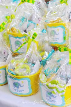 A Bright and Fun First Birthday!  Frosted Events--  The cutest little boy birthday party in aqua blue, yellow and green.  Chevron and dot patterns, a gorgeous dessert table, cute elephant party hat and party favors, elephant decorated cookies and cupcakes, a popcorn bar and lots more!   #firstbirthday #boysfirstbirthday #babyelephant #blueandgreen #blueandyellow #kidsparty #desserttable